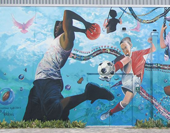 Mural of kids playing and engaging in sports